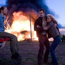 Bill (Brett Rickaby), David (Timothy Olyphant) e Judy (Radha Mitchell) in una sequenza del film The Crazies