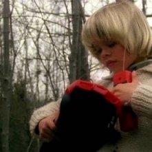 Giovanni Frezza in una scena dell'horror Quella villa accanto al cimitero (1981)