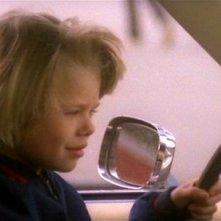 Il piccolo Giovanni Frezza in una scena del film Quella villa accanto al cimitero (1981)