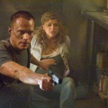 Paul Bettany e Adrianne Palicki in una scena del film Legion
