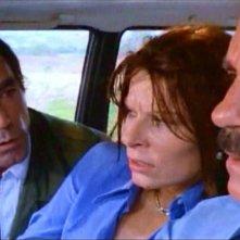 Maurice Poli con Lea Lander e Riccardo Cucciolla in una scena del thriller Semaforo Rosso