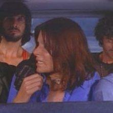 Maurice Poli in auto con Lea Lander, Riccardo Cucciolla, George Eastman e Don Backy in Semaforo Rosso