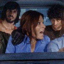 Maurice Poli con Lea Lander, Riccardo Cucciolla, George Eastman e Don Backy in una scena del thriller Semaforo Rosso