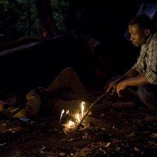 Greer (Jamil Walker Smith) in compagnia del padre Reginald (Sean Blakemore) nell'episodio Lost di Stargate Universe