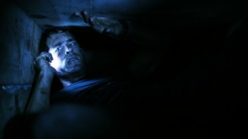 Una delle prime immagini del film Buried con Ryan Reynolds