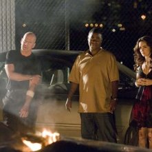 Tracy Morgan, Bruce Willis e Michelle Trachtenberg in una scena di Cop Out
