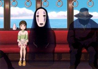 Chihiro e il misterioso Senza Volto  in una scena de La città incantata - Spirited Away