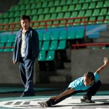 Dre (Jaden Smith) e Mr. Han (Jackie Chan) si allenano per il torneo nel film Karate Kid