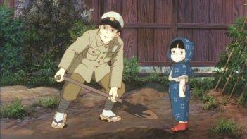 Seita e Setsuko in una sequenza del film d'animazione La tomba per le lucciole