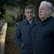 George Clooney e Paolo Bonacelli in una scena del thrille The American