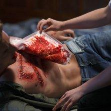 Oliver (Justin Hartley) gravemente ferito nell'episodio La regina rossa di Smallville