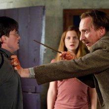 Una scena del film Harry Potter e i Doni della Morte - parte 1 con Daniel Radcliffe, David Thewlis e Bonnie Wright