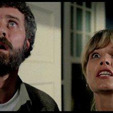 Carlo De Mejo e Janet Agren in una scena del film Paura nella città dei morti viventi
