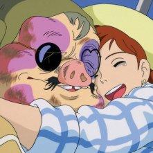 La giovane Fio con il protagonista del film Porco Rosso