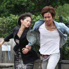 Manami Konishi e Keisuke Koide in una scena del film Strangers in the City