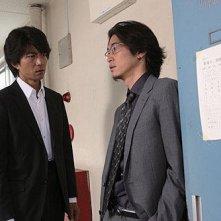 Tôru Nakamura e Yosuke Kubozuka in una scena di Strangers in the City