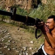 Liao Fan nell'action Let the Bullets Fly