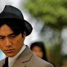 Primo piano di Chen Kun dal film Let the Bullets Fly