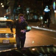 Garrett Hedlund in una scena del film Tron Legacy