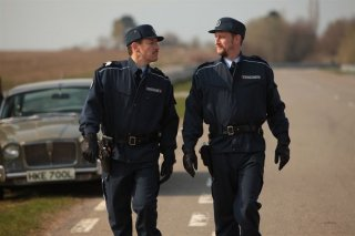 Benoît Poelvoorde e Dany Boon in uniforme per la commedia Rien à déclarer