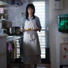 Una scena del film Kazoku X
