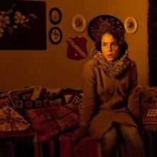 Noomi Rapace in un momento drammatico del film Beyond
