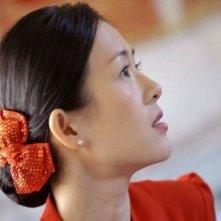 Un intenso primo piano di Zhang Ziyi dal film Mo shu wai zhuan