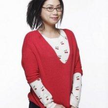 Liza Lapira in una foto promozionale della serie televisiva Apartment 23