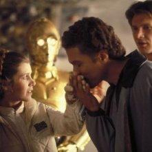 Carrie Fisher, Billy Dee Williams e Harrison Ford in una scena de L'impero colpisce ancora