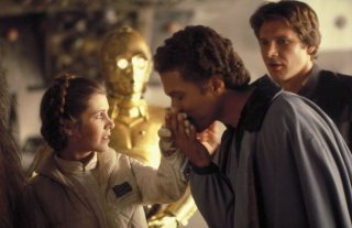 Carrie Fisher, Billy Dee Williams e Harrison Ford in una scena de L'impero colpisce ancora
