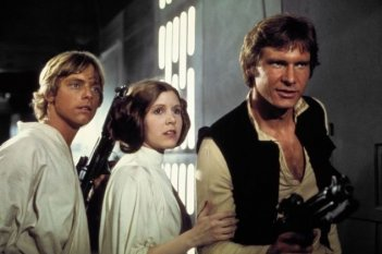 Carrie Fisher, Mark Hamill e Harrison Ford in una scena di Guerre Stellari