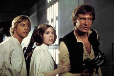 Carrie Fisher, Mark Hamill e Harrison Ford in una scena di Guerre Stellari