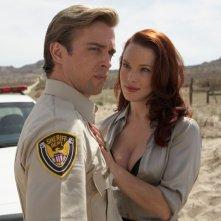 Ron Melendez ed Erin Cummings in una scena del film Bitch Slap - Le superdotate