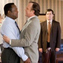 Isiah Whitlock Jr., John C. Reilly e (sul fondo) Ed Helms nel film Cedar Rapids