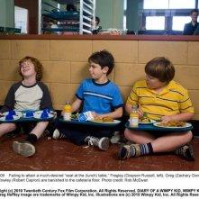 Zachary Gordon tra Grayson Russell e Robert Capron in una scena di Diary of a Wimpy Kid con