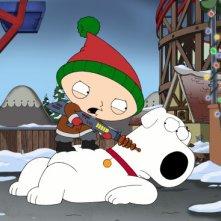 Stewie minaccia Brian in Road to the North Pole de I Griffin