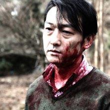 Primo piano di Mitsuru Fukikoshi, tormentato protagonista di Cold Fish di Sono Sion