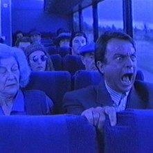 Sam Neill nel film Il seme della follia (1995)