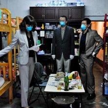 Contagion: Marion Cotillard e Chin Han e Sun Feng nel film