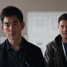 A sinistra, Richie Ren nel film Life Without Principle