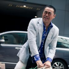 Lau Ching Wan in una scena del film Life Without Principle, di Johnny To