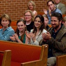 Gerard Butler in Machine Gun Preacher con Kathy Baker, Madeline Carroll e Michelle Monaghan
