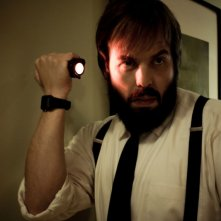 Insidious: Angus Sampson in una scena dell'horror diretto da James Wan