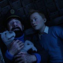 Tintin, capitan Haddock e Snowy in una scena di Le Avventure di Tintin: il segreto dell'unicorno