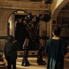 Hugh Jackman insieme ad Evangeline Lily e Dakota Goyo in una scena Real Steel