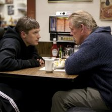 Nick Nolte insieme a Tom Hardy in una scena del film drammatico Warrior