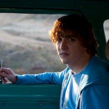 Magic Valley: Kyle Gallner a bordo di un'auto in una scena del film drammatico di Jaffe Zinn