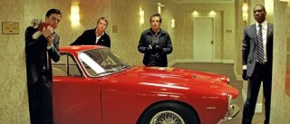 Casey Affleck, Matthew Broderick, Ben Stiller e Eddie Murphy in una divertente scena di Tower Heist: Colpo ad alto livello