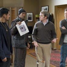 Eddie Murphy, Matthew Broderick, Michael Peña e Casey Affleck in una scena di Tower Heist: Colpo ad alto livello