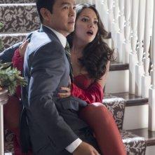 John Cho in una scena di A Very Harold & Kumar Christmas con Paula Garces